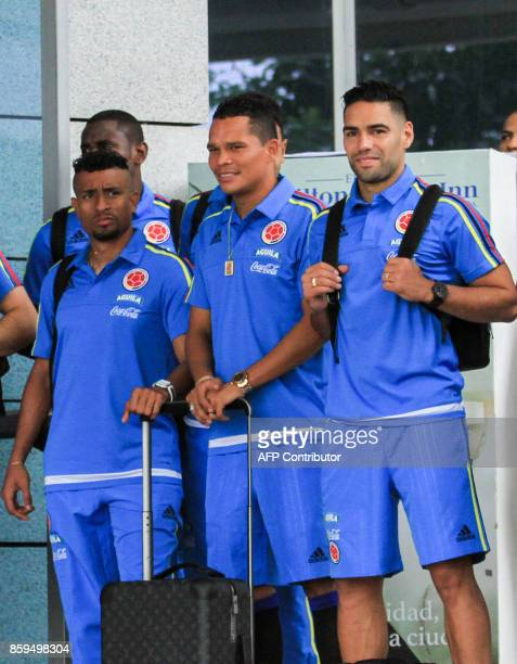 Colombia's players Farid Diaz Carlos Bacca and Radamel Falcao smile at fans on their way to the Ernesto Cortissoz International Airport in...