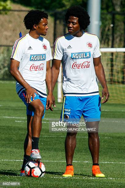 Colombia's players Juan Cuadrado and Carlos Sanchez look on during a training session at the Red Bull Academy in Whippany New Jersey on June 14 2016...