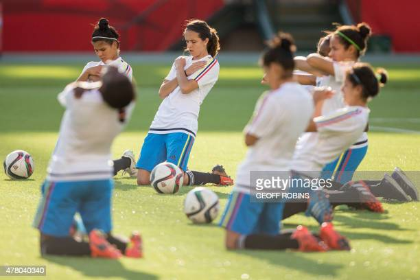 Colombia's players stretch during the team's training session at the FIFA Women's World Cup in Edmonton Canada on June 21 2015 Colombia is set to...