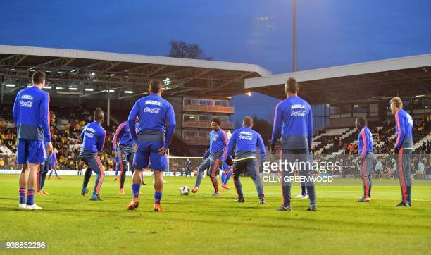 Colombia's players warms up ahead of the International friendly football match between Australia and Colombia at Craven Cottage in London on March 27...