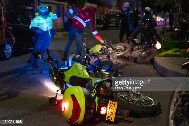 Colombia's police officer crashed his bike after demonstrators threw debree and rocks to them at the Villa Luz CAI police station were police...
