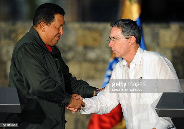 Colombia's President Alvaro Uribe shakes hands with Venezuela's President Hugo Chavez after a joint press conference on January 24 in Cartagena...