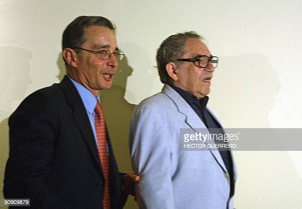 Colombia's President Alvaro Uribe walks with Literature Nobel Prize Gabriel Garcia Marquez during a meeting with Colombia's community in Mexico City...