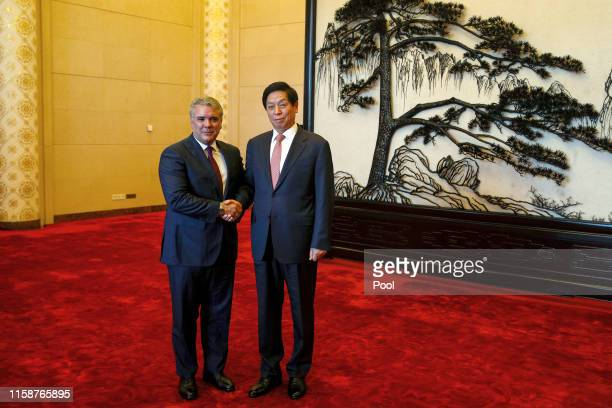 Colombia's President Ivan Duque is greeted by Chinese National People's Congress Standing Committee Chairman Li Zhanshu before proceeding to their...