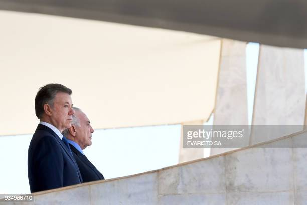 TOPSHOT Colombia's President Juan Manuel Santos and Brazilian President Michel Temer listen to their national anthems during the former's welcoming...