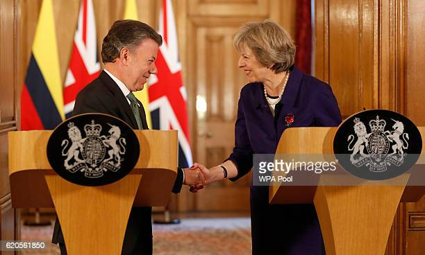 Colombia's President Juan Manuel Santos and Britain's Prime Minister Theresa May shake hands during a press statement at 10 Downing Street on...