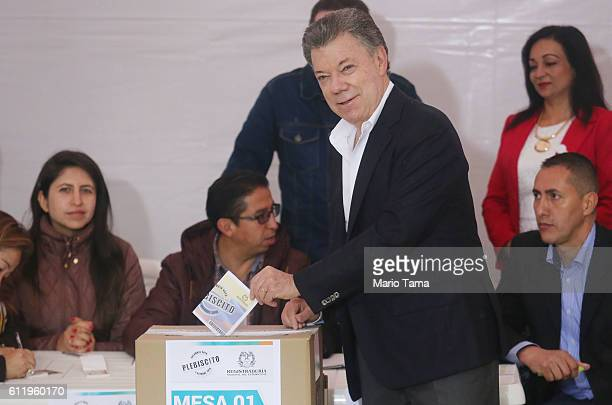 Colombia's President Juan Manuel Santos casts his ballot in the referendum on a peace accord to end the 52yearold guerrilla war between the FARC and...