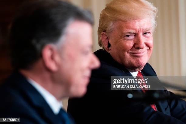TOPSHOT Colombia's President Juan Manuel Santos speaks as US President Donald Trump listens during a press conference in the East Room of the White...