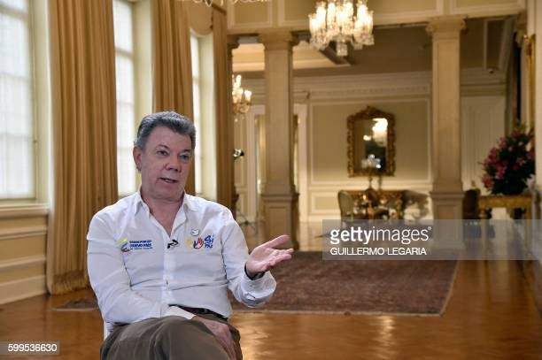 Colombia's President Juan Manuel Santos speaks during an interview with AFP at Casa de Narino presidential palace in Bogota Colombia on September 5...