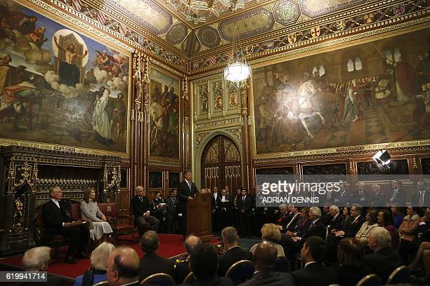 Colombia's President Juan Manuel Santos stands at a lecturn and delivers an address to members of both the House of Commons and the House of Lords in...