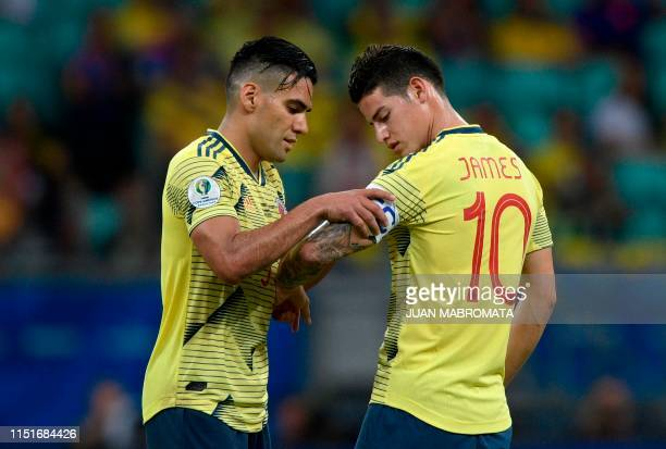 Colombia's Radamel Falcao gives the captain band to teammate James Rodriguez as he is being substituted during their Copa America football tournament...