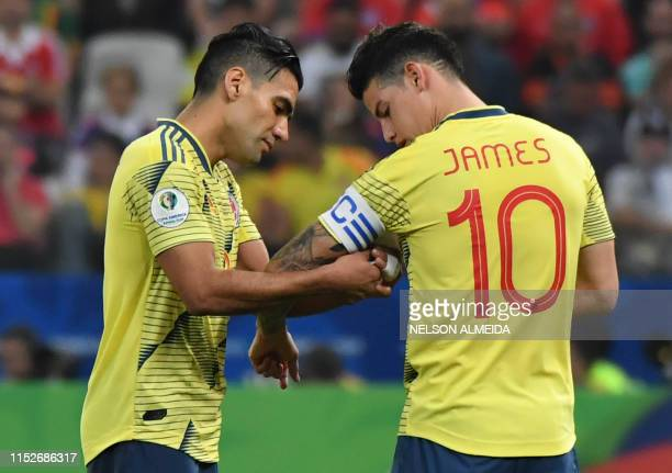 Colombia's Radamel Falcao gives the captain band to teammate James Rodriguez as he is being substituted during the Copa America football tournament...