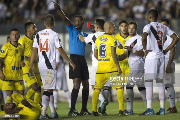 Colombia's referee Jose Argote shows the red card to Brazil's Vasco da Gama player Erazo during their 2018 Libertadores Tournament football match at...