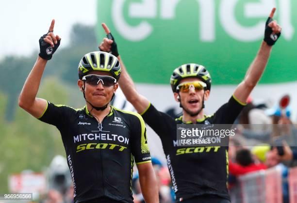 Colombia's rider of team MitcheltonScott Johan Esteban Chaves crosses the finish line ahead of teammate Britain's rider of team MitcheltonScott Simon...