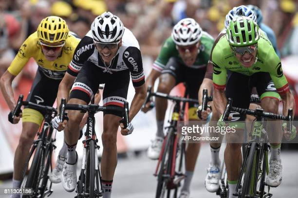 TOPSHOT Colombia's Rigoberto Uran sprints to win ahead of Great Britain's Christopher Froome wearing the overall leader's yellow jersey France's...
