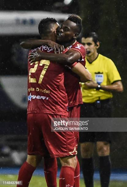 Colombia's Rionegro Aguilas Jader Arias celebrates with teammate Jonathan Lopera after scoring against Argentina's Independiente during their Copa...