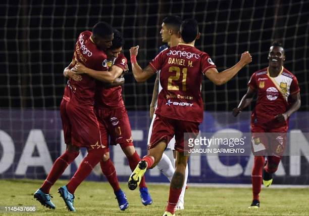 Colombia's Rionegro Aguilas Kevin Salazar celebrates with teammates after scoring against Argentina's Independiente during their Copa Sudamericana...