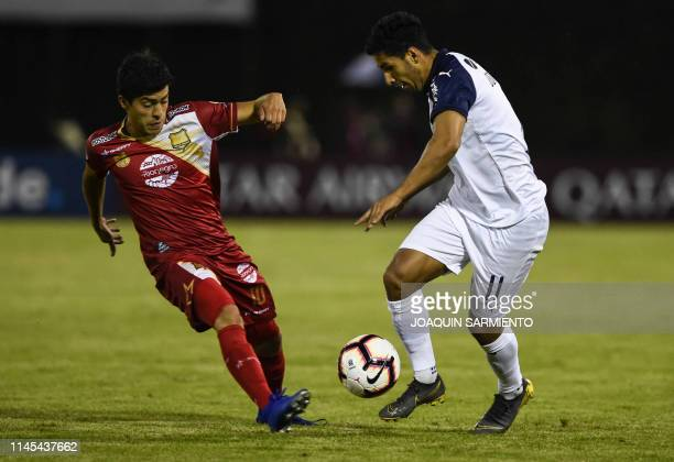 Colombia's Rionegro Aguilas Kevin Salazar vies for the ball with Argentina's Independiente Cecilio Dominguez during a Copa Sudamericana football...
