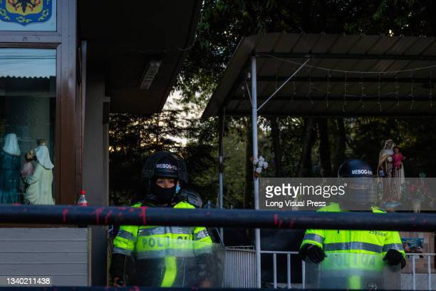 Colombia's riot police and riot police squadron protect the Villa Luz CAI police station were police officers tortured Javier Ordonez on September 9...