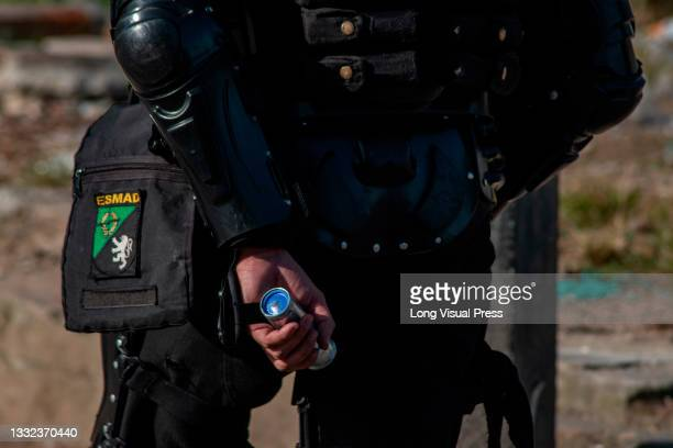 Colombia's riot police officer holds a tear gas canister as demonstrations ended in late-night clashes between riot police and Demonstrators as...