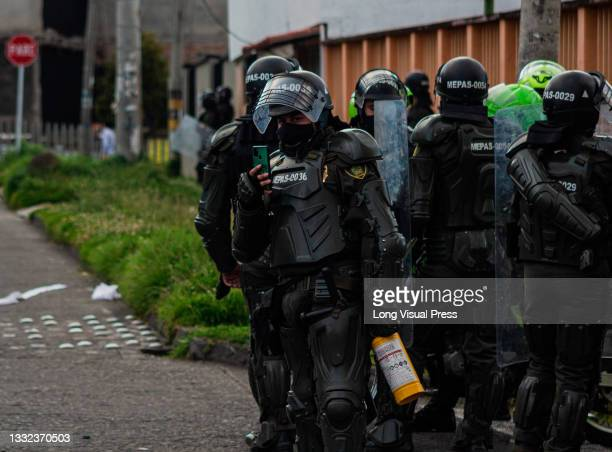 Colombia's riot police officers as demonstrations ended in late-night clashes between riot police and Demonstrators as Colombia marks 3 months of...