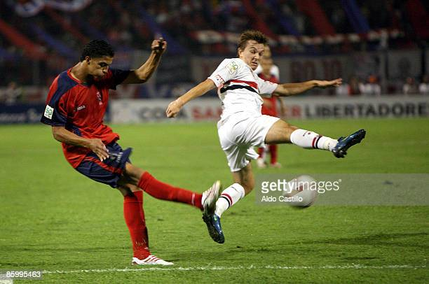 Colombia's Roger Canas fights for the ball against Brazil's Dagoberto during their Santander Libertadores Cup soccer match at the Atanasio Girardot...