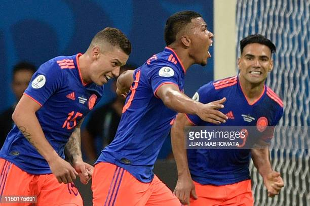 TOPSHOT Colombia's Roger Martinez celebrates with teammates Mateus Uribe and Radamel Falcao after scoring against Argentina during their Copa America...