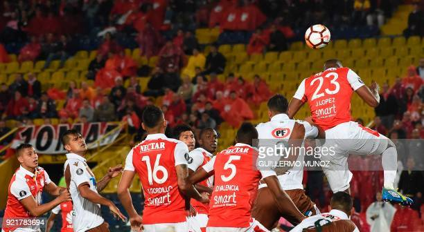 Colombia's Santa Fe player Javier Lopez vies for the ball against Chile's Wanderers Mario Lopez player during their Copa Libertadores football match...