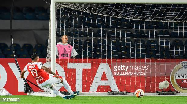 Colombia's Santa Fe player Wilson Morelo scores a goal against Chile's Wanderers during their Copa Libertadores football match at the El Campin...