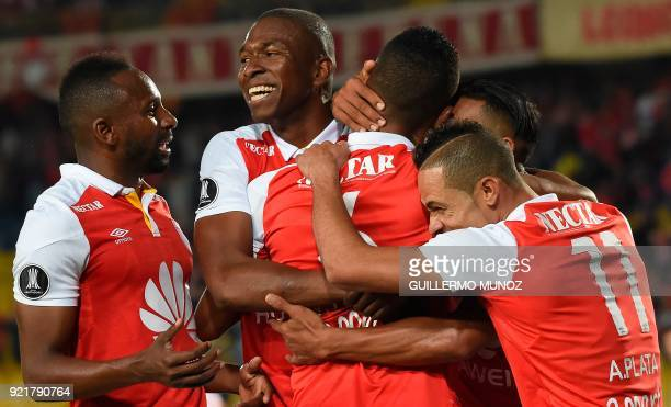 Colombia's Santa Fe players celebrate their goal against Chile's Santiago Wanderers during their Copa Libertadores football match at El Campin...