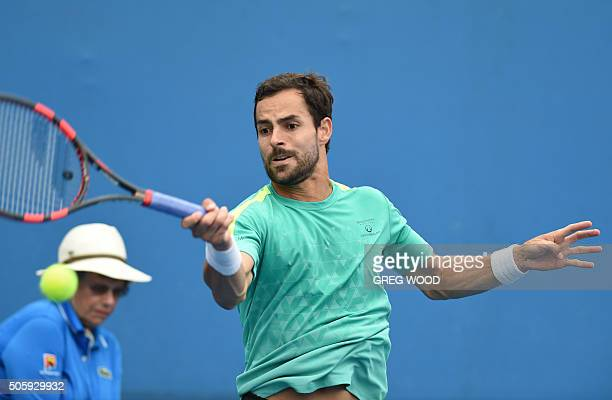 Colombia's Santiago Giraldo plays a forehand return during his men's singles match against Portugal's Joao Sousa on day four of the 2016 Australian...