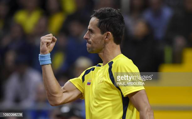 Colombia's Santiago Giraldo reacts during his Tennis Davis Cup qualifier match against Sweden's Elias Ymer at the Sports palace in Bogota on February...