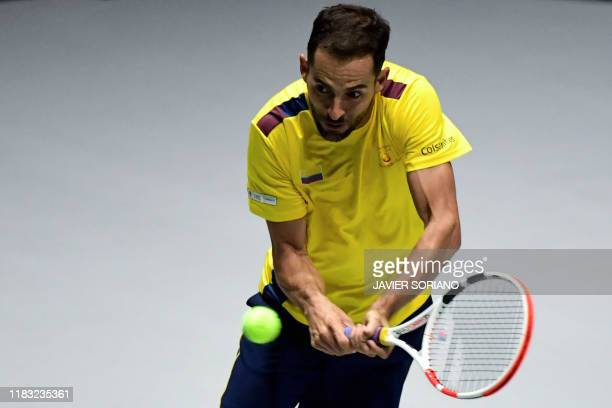 Colombia's Santiago Giraldo returns the ball to Belgium's Steve Darcis during the singles tennis match between Belgium and Colombia at the Davis Cup...