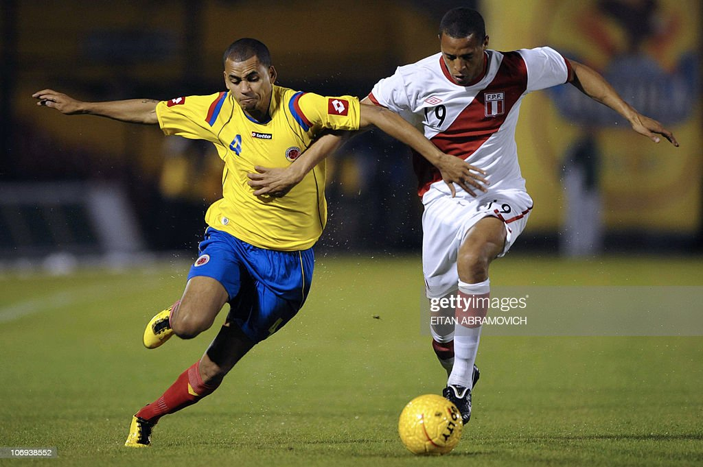 08a31f7be Colombia s Sergio Otalvaro vies for the football with Peru s Jesus ...