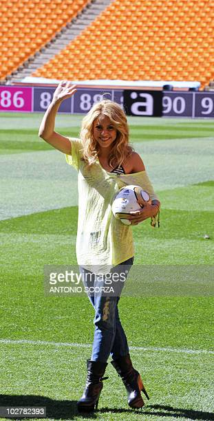 Colombia's singer Shakira holds the Jo'bulani football that will be used for the final of the tournament after a press conference on July 10 2010 at...