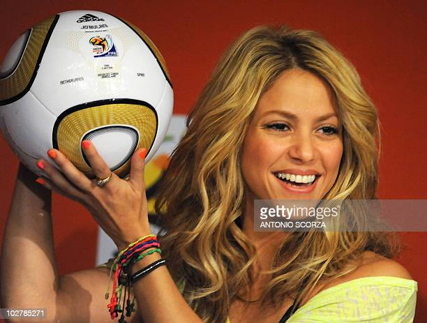 Colombia's singer Shakira holds the Jo'bulani football that will be used for the final of the tournament during a press conference on July 10 2010 at...
