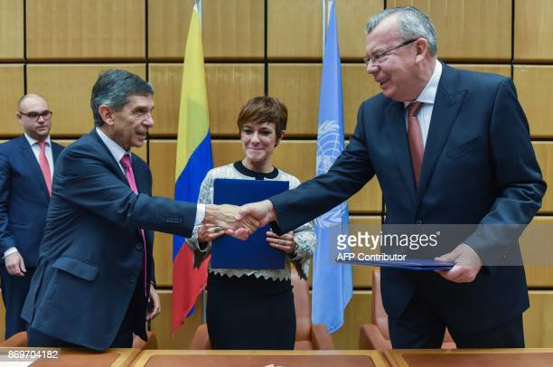 Colombia's special postconflict envoy and Labour Minister Rafael Pardo Rueda shakes hands with United Nations Office on Drugs and Crime Executive...
