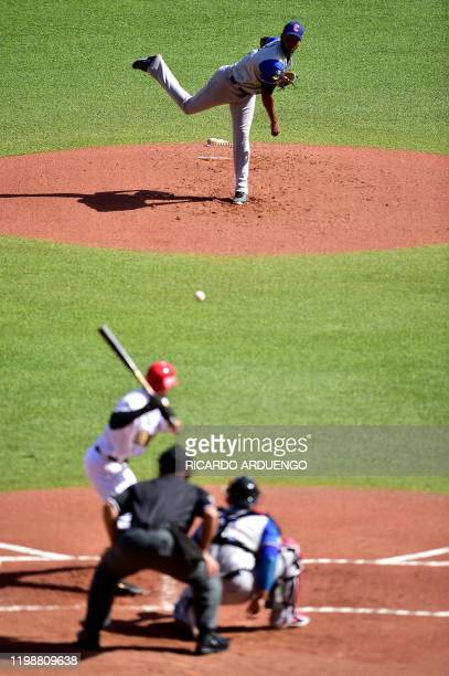 Colombia's starting pitcher Edinson Frias throws to Mexico's Rico Noel during the Caribbean Series baseball tournament at the Hiram Bithorn stadium...