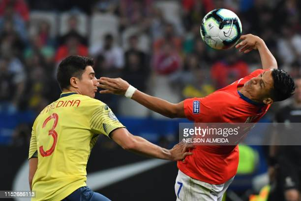 Colombia's Stefan Medina and Chile's Alexis Sanchez vie for the ball during their Copa America football tournament quarterfinal match at the...