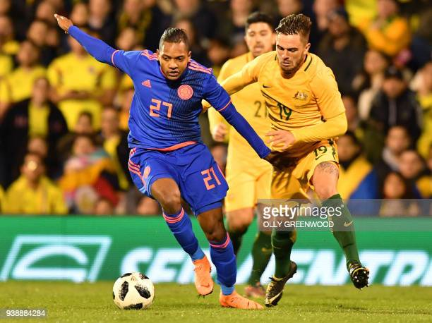 Colombia's striker Jose Izquierdo vies with Australia's defender Josh Risdon during the International friendly football match between Australia and...