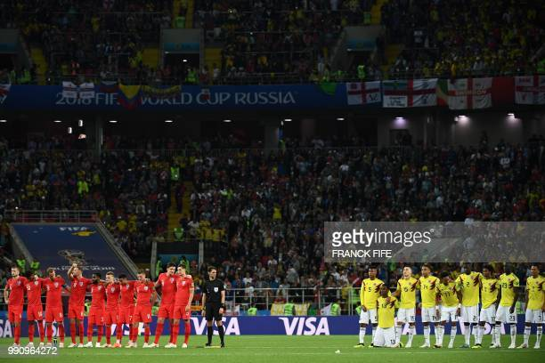 Colombia's team players and England's team players react during the penalty shootout of the Russia 2018 World Cup round of 16 football match between...
