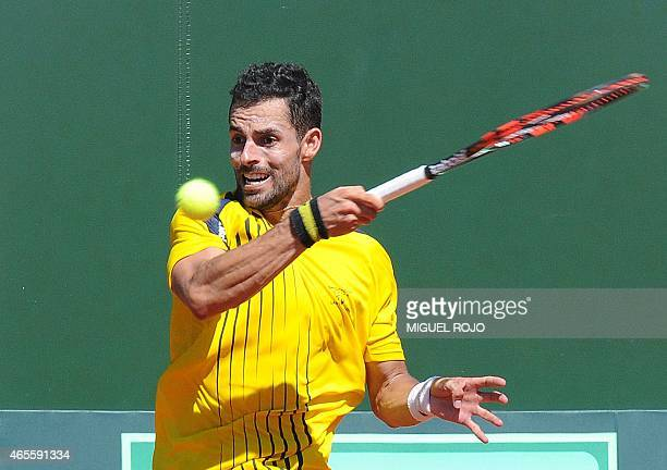 Colombia's tennis player Santiago Giraldo returns the ball to Uruguay's Pablo Cuevas during their Davis Cup Americas Zone Group I singles match in...