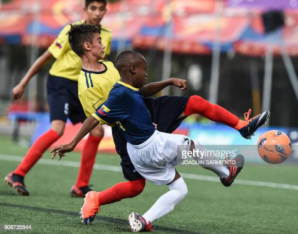 Colombia's Tomas Meza vies for the ball with Ecuador's Diego Cordova during an under13 friendly match between Colombia and Ecuador in Medellin on...