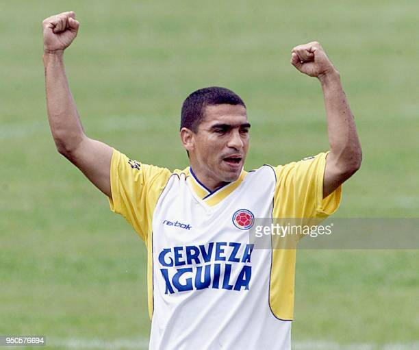 Colombia's Victor Ariztizabal celebrates his team's victory during a practice session in Armenia Colombia 28 July 2001 Colombia is scheduled to play...