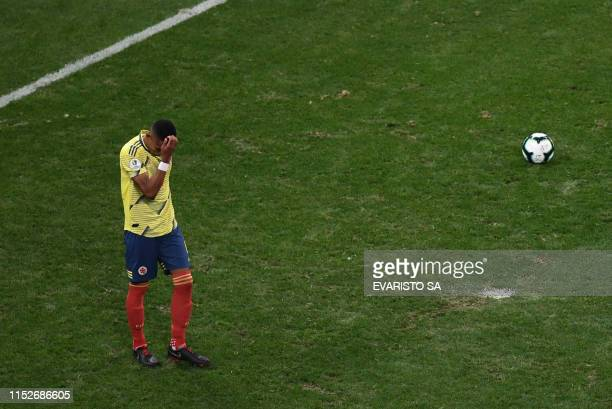 Colombia's William Tesillo gestures after missing his shot during the penalty shootout against Chile after tying 00 during their Copa America...