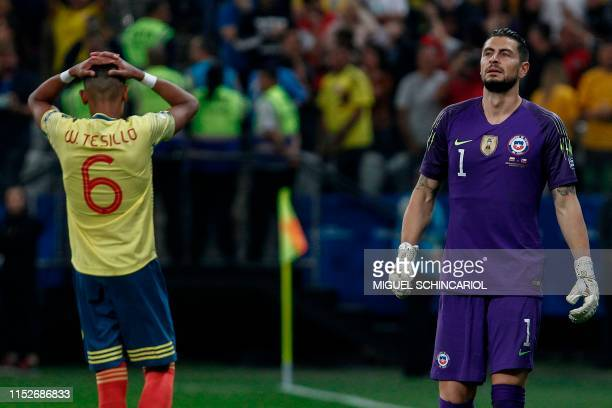 Colombia's William Tesillo gestures next to Chile's goalkeeper Gabriel Arias after missing his shot during the penalty shootout against Chile after...