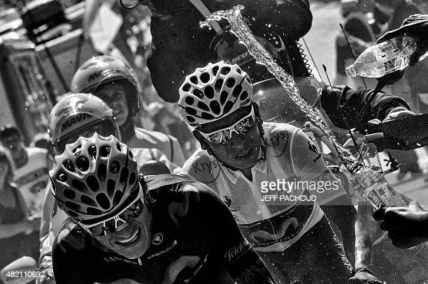 Colombia's Winner Anacona Gomez and Colombia's Nairo Quintana wearing the best young's white jersey ride in a breakaway during the 1105 km twentieth...