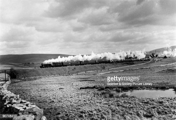 Colombo A3 Class steam locomotive No 60036 leaving Ribblehead Station with the morning Leeds to Glasgow train Photograph by Bishop Eric Treacy Treacy...
