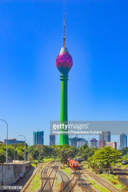 colombo lotus tower, while a train is arriving. taken in sri lanka, desember 02nd 2018. - imagebook stock pictures, royalty-free photos & images