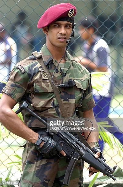 A Sri Lankan commando stands alert as the national cricket team take part in a practice session at The Sinhalese Sports Club Ground in Colombo 17...